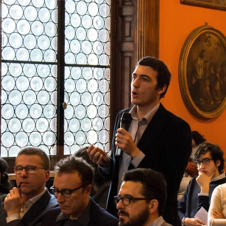 A young man speaks during a debate at a cultural event organized by the Jesuits