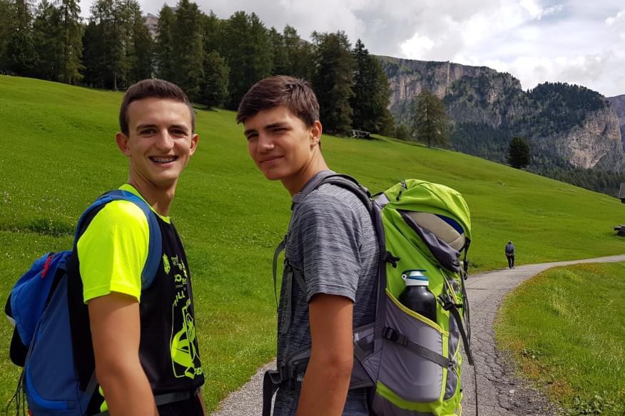 Young ignatian boys on a mountain path