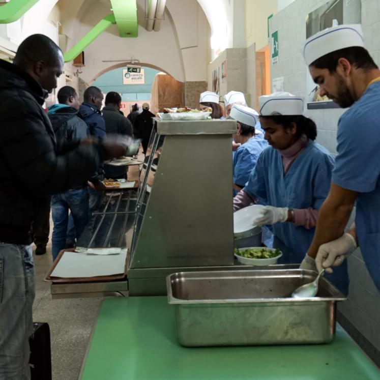 Distribution of meals at the canteen of the Jesuit Refugee Service, Centro Astalli